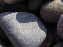 Guijarro de la arena en modo macro imagen de archivo libre de regalías