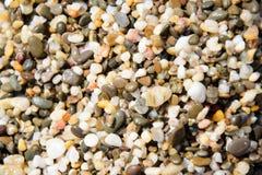 Guijarros en la playa como fondo Imagen de archivo