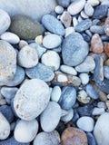 Guijarros lisos en un Pebble Beach Fotos de archivo libres de regalías