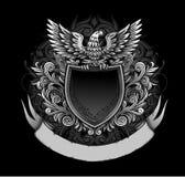 Águila en insignias oscuras del blindaje Imágenes de archivo libres de regalías