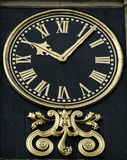 Guilded clock face Stock Photo