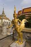 Guilded figures at Wat Phra Kaeo. Thailand. Gilded mythical figures on the upper terrace  of Wat Phra Kaeo. Bangkok Thailand Stock Image