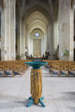 Guildford Cathedral Font. With the High Altar in the background stock photography