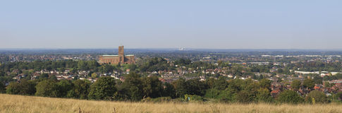 Guildford, panorama. A panoramic high view of Guildford showing the cathedral, residential and industrial areas. 13253 x 4372 image Royalty Free Stock Image