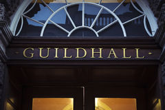 Guildhall sign above grand entrance. Golden lettering at main doorway to town hall Royalty Free Stock Images