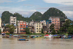 Guilin, China - circa July 2015: Buildings and karst limestone mountains of Guilin and Li  river Royalty Free Stock Photography