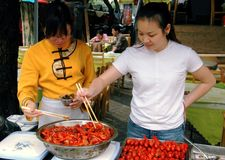 Guilin, China: Women Cooking Shrimp Stock Photos