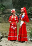 Guilin, China: Women in Zhuang Clothing. Two women wearing the traditional bright red clothing of the ethnic Zhuang people in the Seven Stars Hill Park in Guilin Royalty Free Stock Image