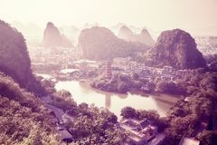 Guilin city surrounded by Karst formations, China. Guilin city surrounded by Karst formations, color toned picture, China Royalty Free Stock Photography
