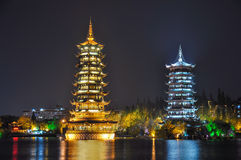 Guilin. Pagodas of Sun and Moon in the lake Stock Images