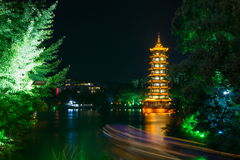 Guilin tower with light trails from a boat Stock Photo