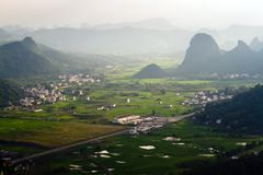 Guilin village at sunset from Moon Hill mountain. Yangshuo Royalty Free Stock Photography