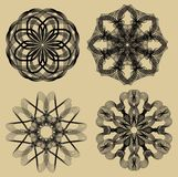 Guilloche set. Black filigree lace patterns on beige background. Fine geometric antique patterns. Circle design motifs. Vector EPS 10 Royalty Free Stock Photos