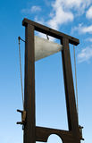 Guillotine. With sharp blade against the blue sky Royalty Free Stock Photos