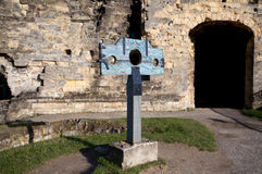 Guillotine over old castle wall. Wooden guillotine in front of old castle stone wall Stock Image
