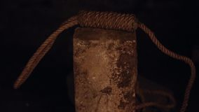 Guillotine, rope falls on stone