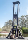 Guillotine. Of the time the tribunal of the Inquisition, is located in Santillana del Mar in Cantabria north of Spain. Is a picture vertically Stock Photo