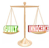 Guilt Vs Innocence 3d Words Gold Scale  Judgment Decision Verdic Royalty Free Stock Images