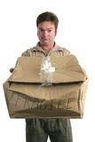 Guilty Delivery Man. A delivery man holding a smashed package and looking guilty royalty free stock images