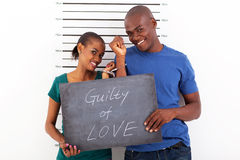 Guilty of love. Fun african young couple guilty of love stock images