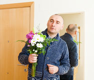 Guilty man with   bouquet Stock Photography