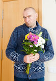 Guilty man with    flowers Royalty Free Stock Photography