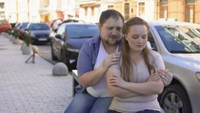 Guilty man making up with upset girlfriend, sitting on street bench, quarrel. Stock footage stock footage