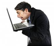 Guilty man peering at x-rated. Humorous portrait of a furtive guilty man peering at x-rated content on his laptop computer with avid eyes, isolated on white Stock Images