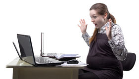 Guilty pregnant woman at work stock images