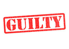 GUILTY. Rubber stamp over a white background royalty free stock images