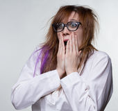 Guilty scientist shaggy woman. On gray background Royalty Free Stock Image
