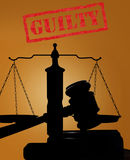 Guilty stamp and gavel with scales Royalty Free Stock Image