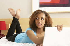 Free Guilty Teenage Girl Using Laptop In Bedroom Stock Photo - 11501430