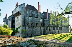 Guimaraes Castle. Old medieval stone castle in Guimaras, Portugal, with park and against blue sky Stock Image