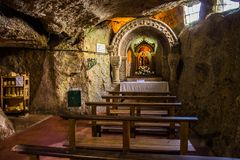 Small chapel carved into the rocks Royalty Free Stock Image