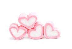 Guimauve de forme de coeur avec sur le fond, forme rose mars de coeur Photos libres de droits