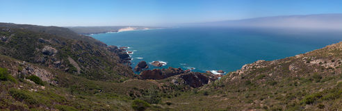 Guincho beach from Cabo da Roca. Guincho beach and seascape panorama as seen from close to Cabo da Roca. Sintra, Portugal Royalty Free Stock Images