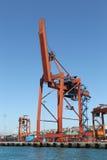 Guindaste alaranjado do porto Fotografia de Stock