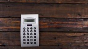 Guindaste da c?mera, tabela de trabalho da mesa da vista superior com calculadora filme