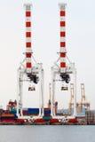Guindaste e recipiente portuários da carga Fotografia de Stock Royalty Free