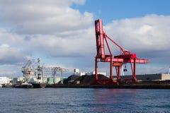 Guindaste vermelho do porto foto de stock