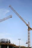 Guindastes de construção na operação Fotografia de Stock