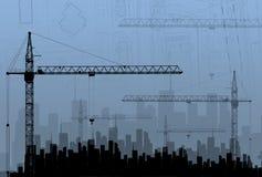 Guindastes de construção nas construções do fundo ilustração stock