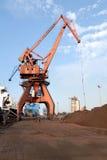 Guindastes pesados no porto Imagens de Stock