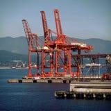 Guindastes portuários da carga imagem de stock royalty free