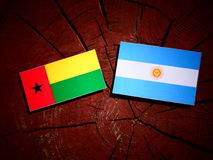 Guinea Bissau flag with Argentinian flag on a tree stump isolate Royalty Free Stock Photo