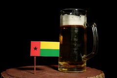 Guinea Bissau flag with beer mug  on black Stock Image