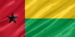 Guinea Bissau Flag. With waving on satin texture stock photo
