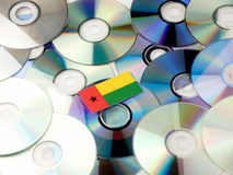 Guinea Bissau flag on top of CD and DVD pile isolated on white. Guinea Bissau flag on top of CD and DVD pile isolated Stock Image