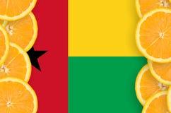 Guinea Bissau flagga i vertikal ram för citrusfruktskivor royaltyfri foto